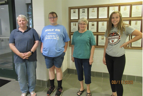 Patricia Lehman, Savana Hiltz, Jane Wilcox and Haylee Moore were welcomed as new members of the Wolman-Minskey American Legion Auxiliary Unit 317. Not pictured are Joan Holtz, Alice and Kennedy Miller.