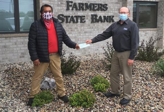 Farmers State Bank, Wild Rose, presents check to El Popo Restaurant