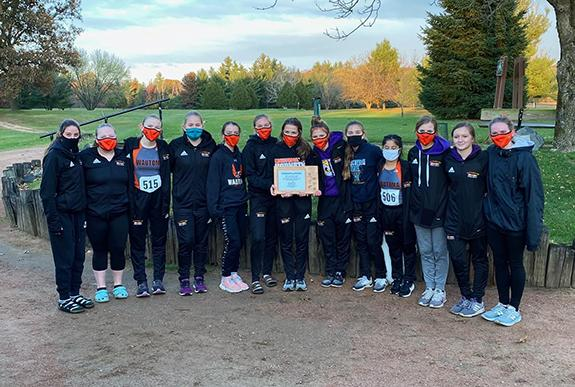 The 2020 Conference Champion Girls Cross Country Team, pictured left to right: Tegan Reitz, Falyn Krempp, Nina Skweres, Layla Grasser, Megan Miller, Madylyn Woyak, Laney Panich, Mya Bahr, Isybela Woyak, Clare Williams, Jaidyn Knueppel, Laney Havlovitz, and Esther Brooks