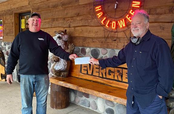Jim Button donates to Pine River Library Enhancement Fund