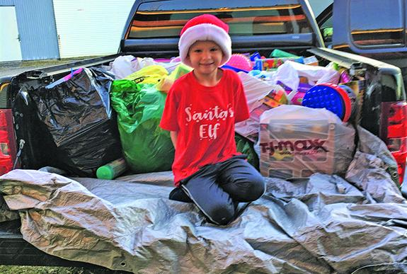 Finn Phillips, 7, set out to spread holiday cheer to those in need this holiday season.