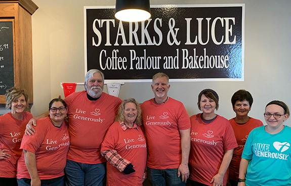 Dawn Woyak, Selena Elton-Garcia, Pete and Karen Campbell, Pastor Roger and Tammy Wright, Cindy Johnson and Kayte Miller represent the Thrivent Action Team at Starks & Luce in Plainfield.
